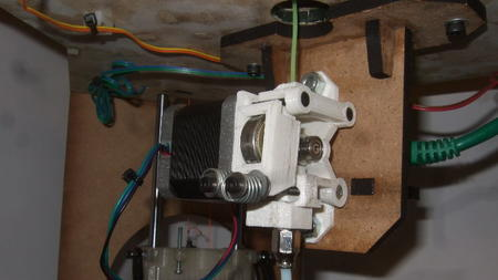 Extruder mounted below top